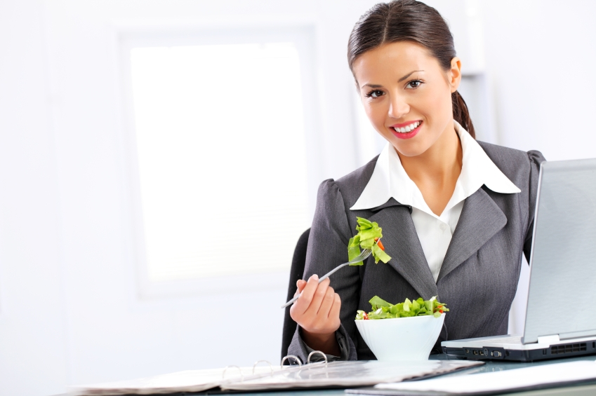 Business woman eating salad_iStock_000014935246Small
