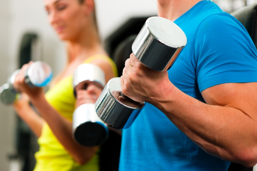 couple in gym exercising with dumbbells_iStock_000015463854Small