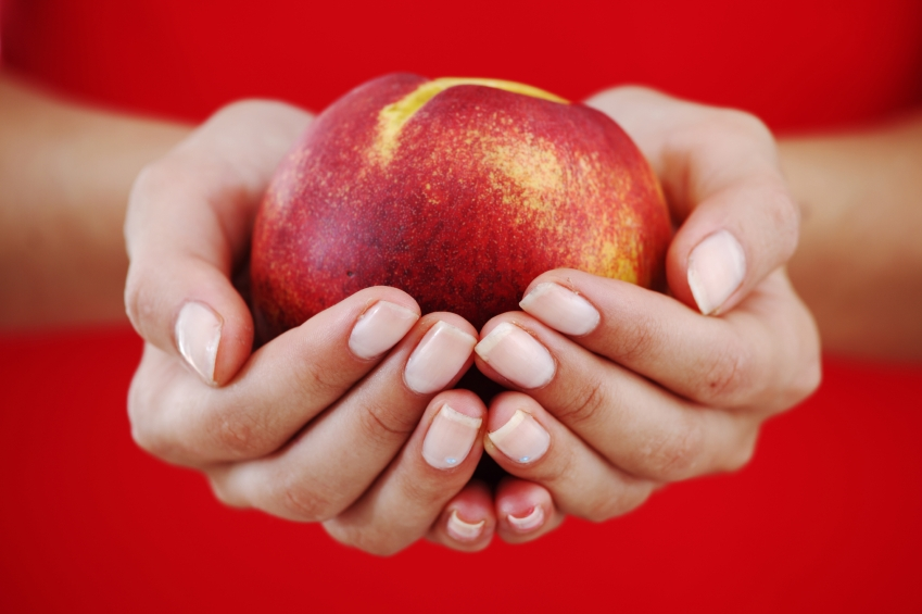 Peach in hand_iStock_000017915220Small
