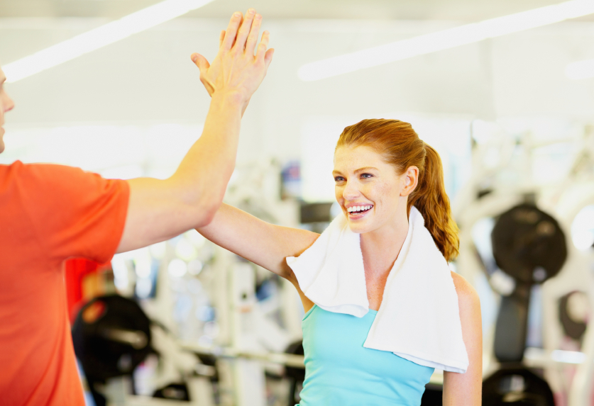 Woman and man celebrating success at gym_iStock_000018336663Small