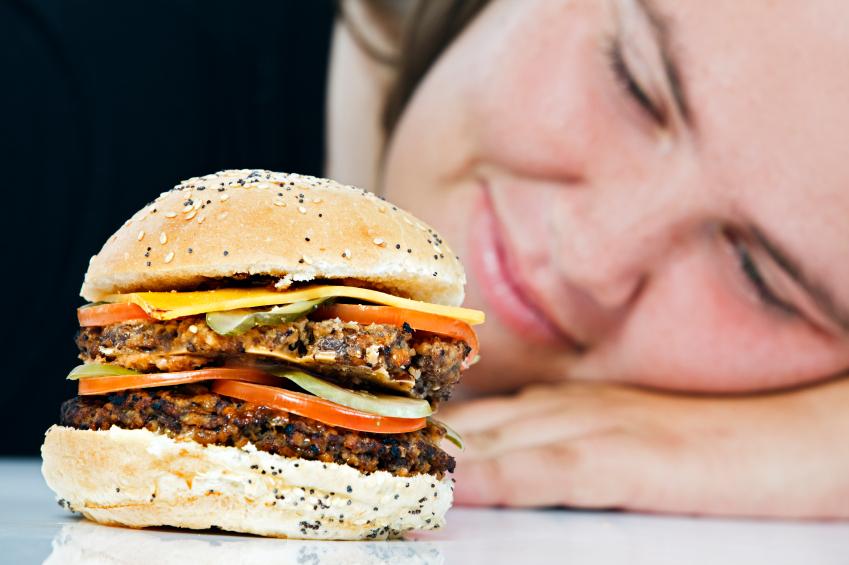 Woman staring hamburger