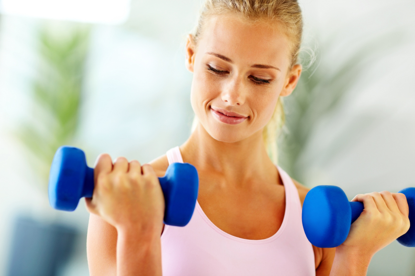 Woman with dumbells