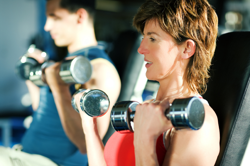 Man and woman with dumbells