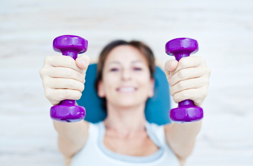 Female athlete dumbells