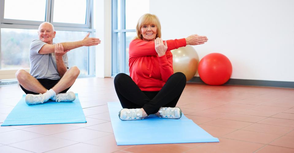 Senior Couple Doing Stretches