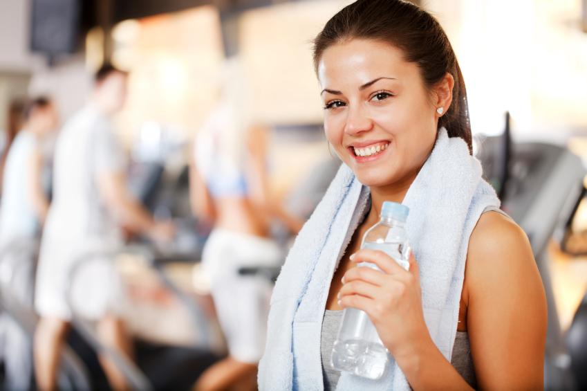 Girl holding bottle of water