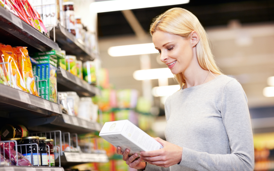 Woman reading nutritional label