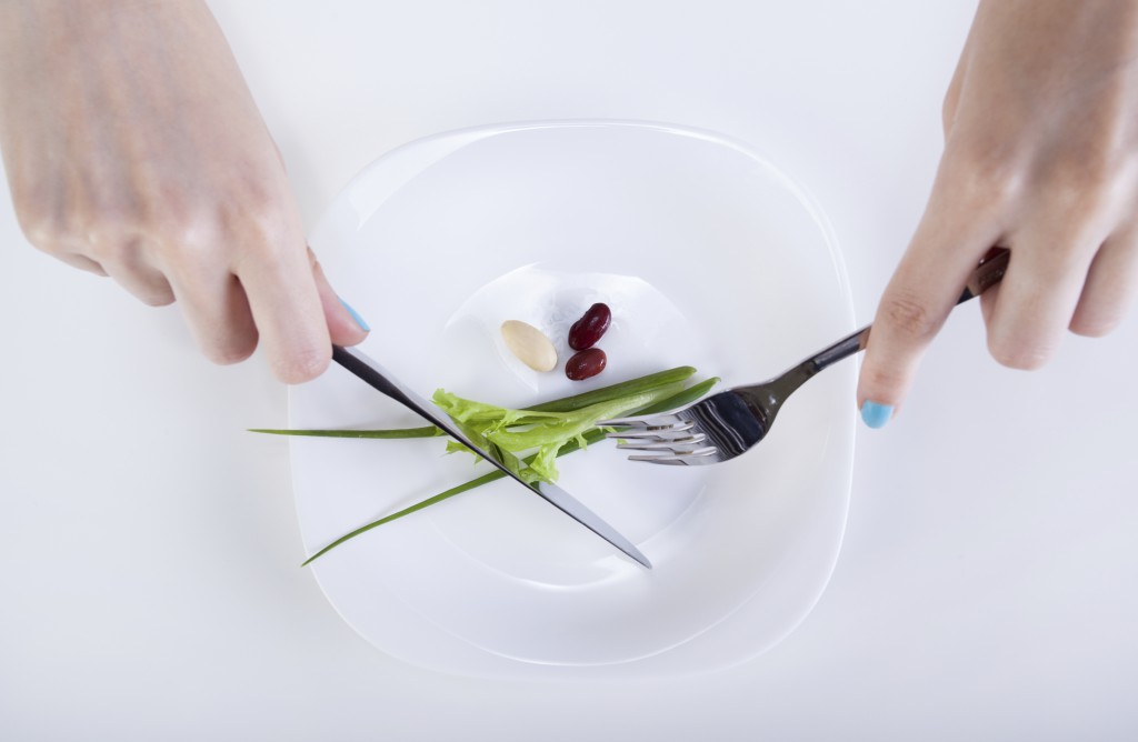 Plate with small diet meal on it