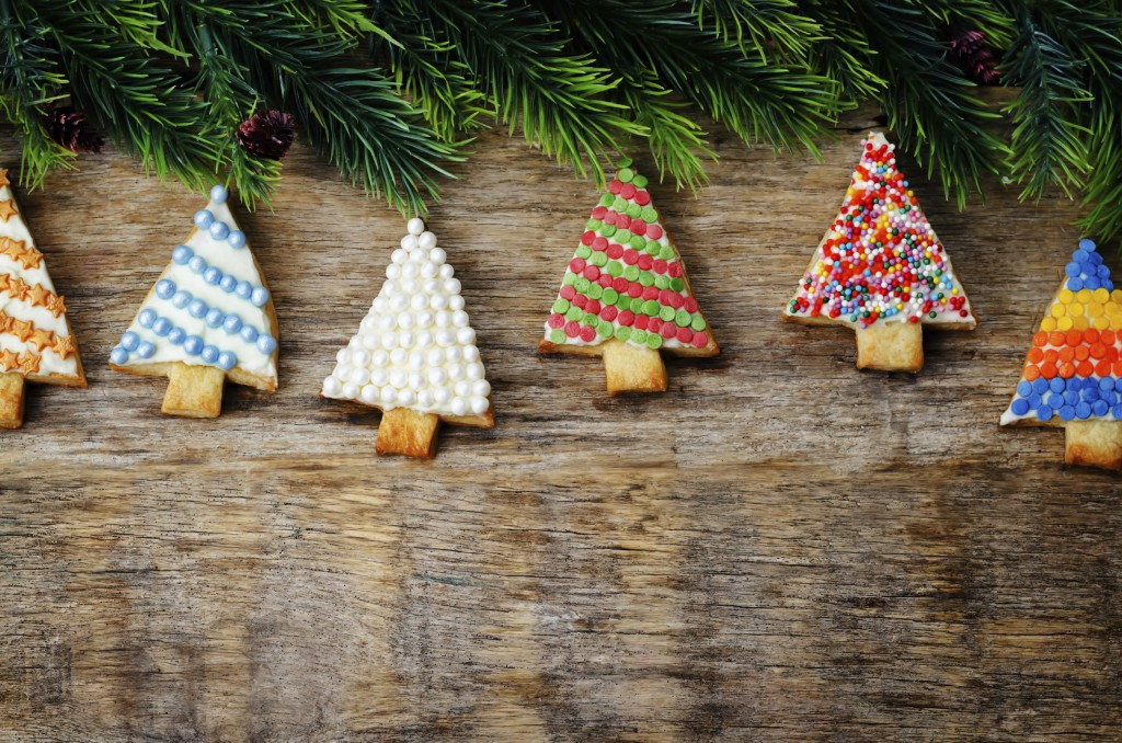 colored Christmas tree cookies on a dark wood background. toning. selective Focus