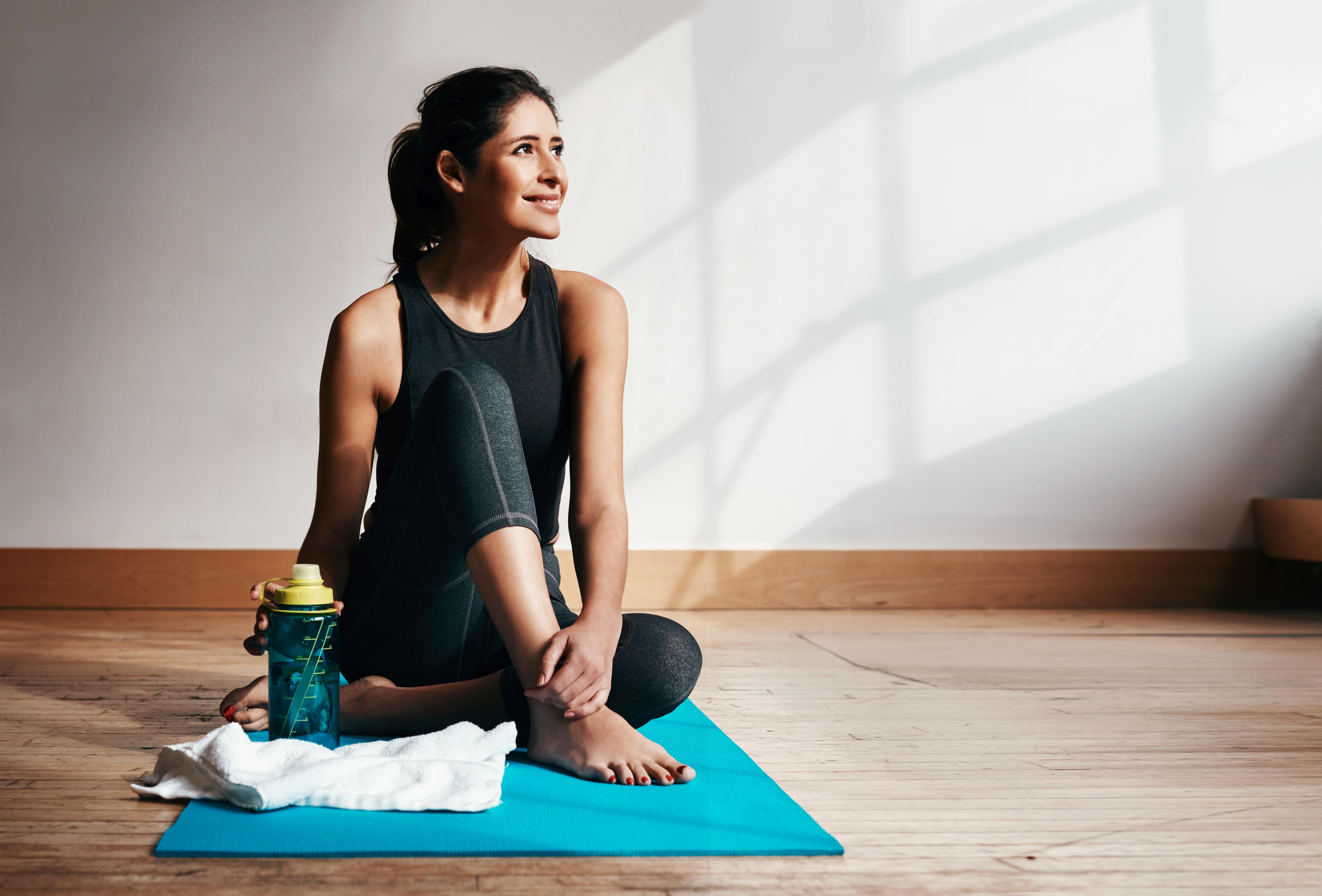 Personne sur tapis de Yoga